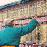 Mongol turns on prayer wheels