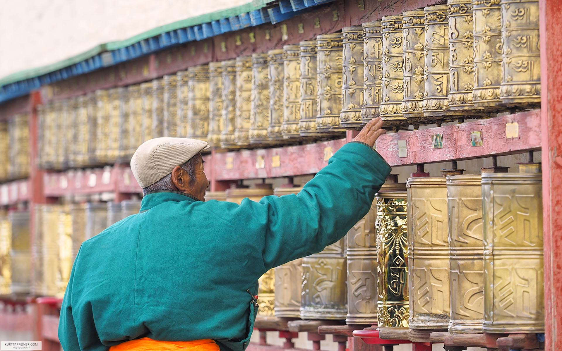 Mongol turns on prayer wheels